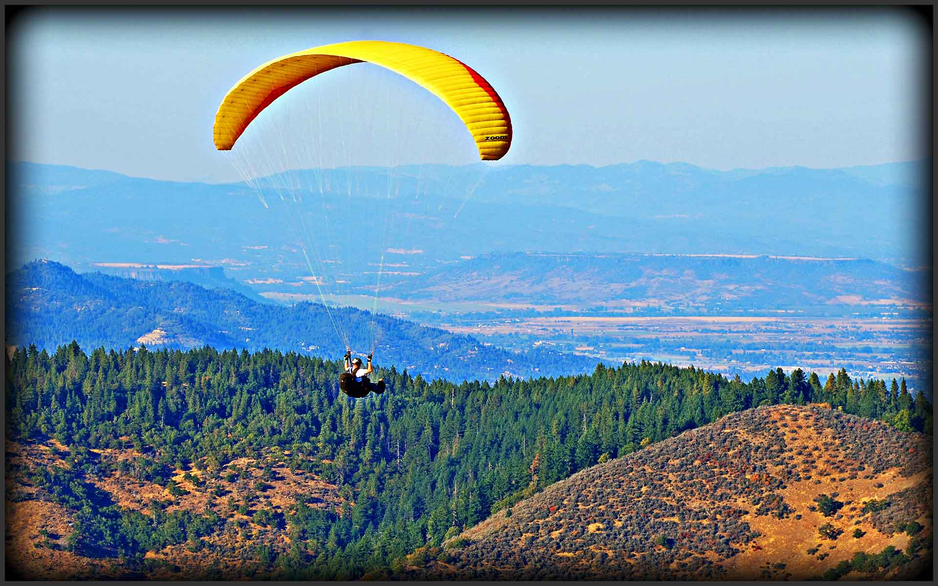 Hang Gliding Pilot over Rogue Valley